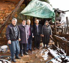 Yangında evlatlarını kaybeden ailelere yardım